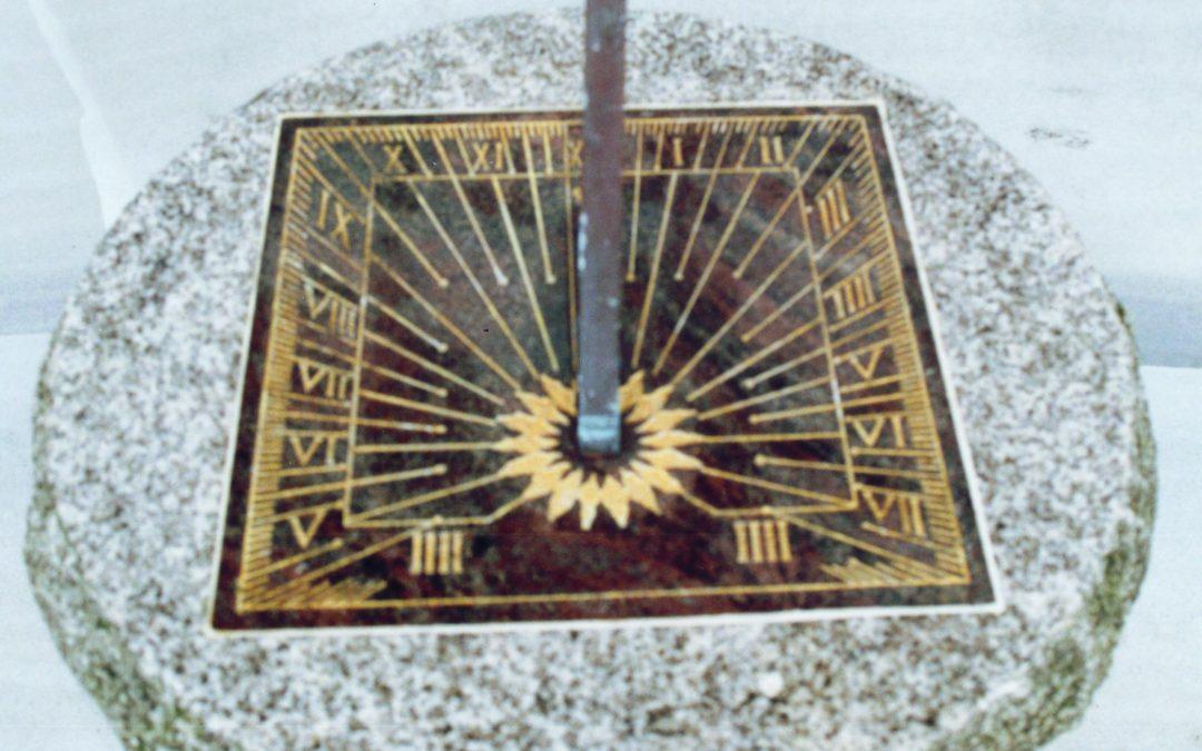 Sundial on granite pedestal